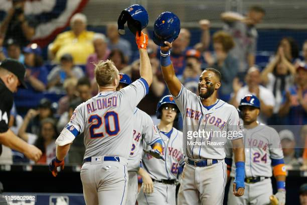 Pete Alonso of the New York Mets celebrates with Amed Rosario after hitting a threerun home run in the ninth inning against the Miami Marlins at...