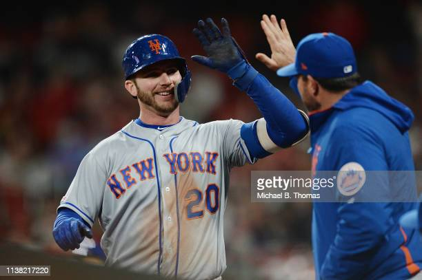 Pete Alonso of the New York Mets celebrates with teammates after hitting a solo homerun in the sixth inning against the St Louis Cardinals at Busch...