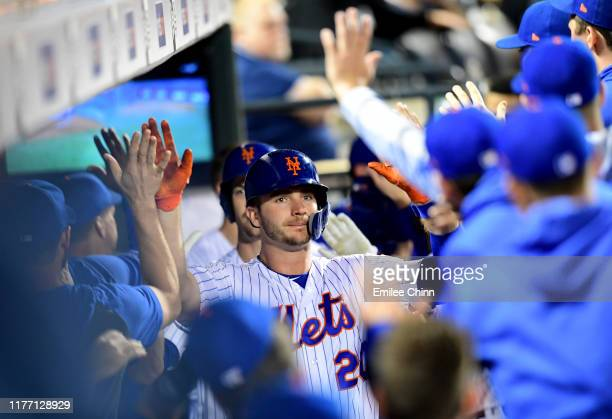 Pete Alonso of the New York Mets celebrates with teammates after hitting a home run in the second inning of their game against the Miami Marlins at...