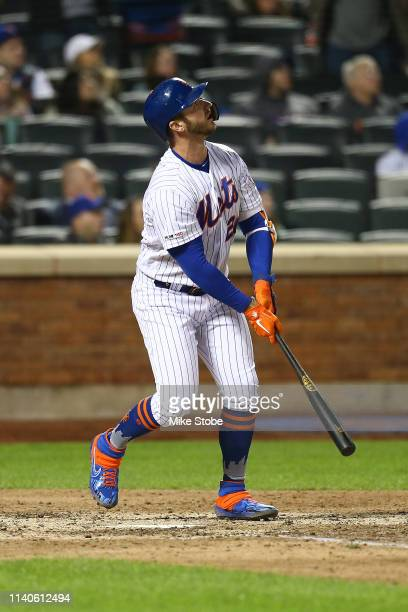 Pete Alonso of the New York Mets connects on a three run home run in the seventh inning against the Milwaukee Brewers at Citi Field on April 27 2019...