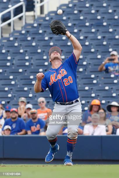 Pete Alonso of the New York Mets fields the ball hit by Jose Altuve of the Houston Astros during a spring training game at The Fitteam Ballpark of...