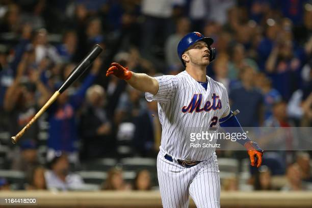 Pete Alonso of the New York Mets flips his bat after hitting a home run against the Chicago Cubs during the fourth inning of a game at Citi Field on...