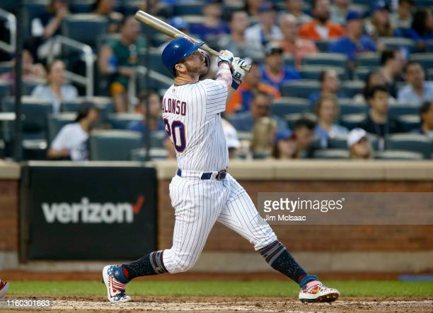 Pete Alonso of the New York Mets follows through on a fourth inning home run against the Philadelphia Phillies at Citi Field on July 05 2019 in New...