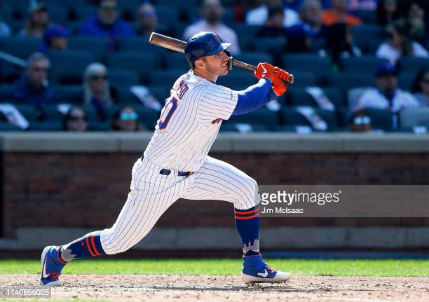 Pete Alonso of the New York Mets follows through on an eighth inning home run against the Washington Nationals at Citi Field on April 06 2019 in the...