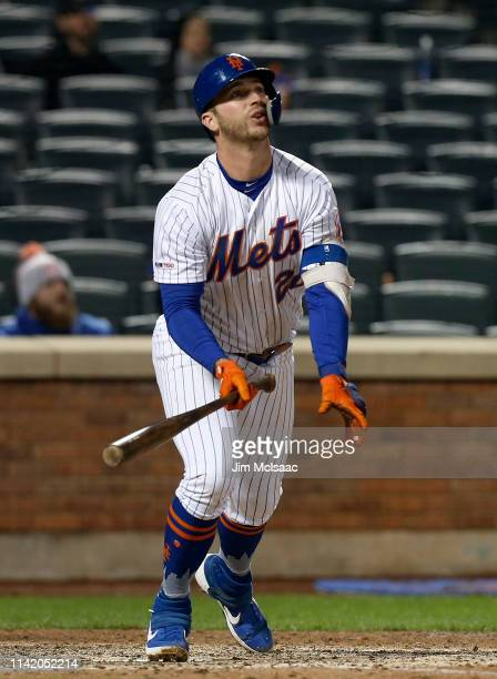 Pete Alonso of the New York Mets follows through on his seventh inning home run against the Minnesota Twins at Citi Field on April 09 2019 in the...