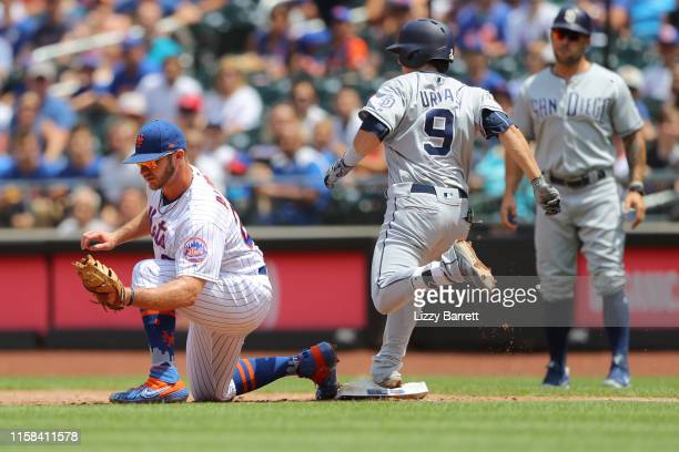 Pete Alonso of the New York Mets forces an out against Luis Urias of the San Diego Padres during the game between the San Diego Padres and the New...
