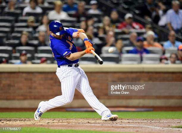 Pete Alonso of the New York Mets hits a home run in the first inning of their game against the Atlanta Braves his 52nd home run of the season and...