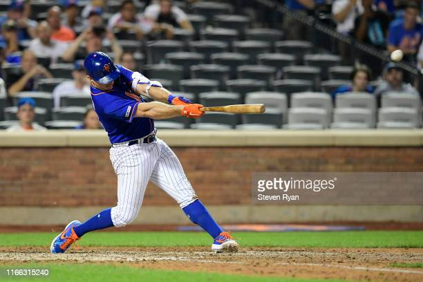Pete Alonso of the New York Mets hits a seventh inning and eventual gamewinning home run against the Miami Marlins at Citi Field on August 05 2019 in...