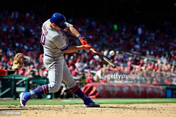Pete Alonso of the New York Mets hits a single for his first MLB hit in the eighth inning against the Washington Nationals on Opening Day at...