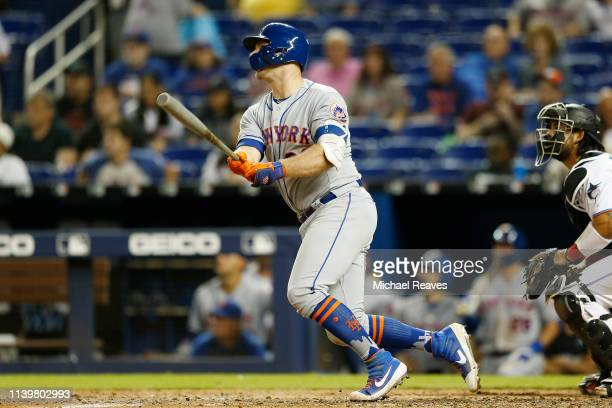 Pete Alonso of the New York Mets hits a threerun home run in the ninth inning against the Miami Marlins at Marlins Park on April 01 2019 in Miami...