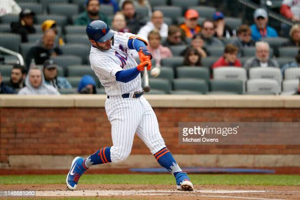 Pete Alonso of the New York Mets hits a triple to left field during the first inning against the Milwaukee Brewers at Citi Field on April 28 2019 in...