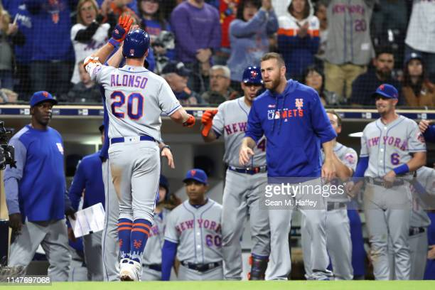 Pete Alonso of the New York Mets is congratulated at the dugout after hitting a tworun homerun during the ninth inning of a game against the San...