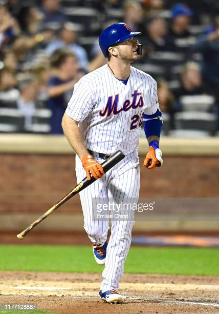 Pete Alonso of the New York Mets looks at the ball after hitting a home run in the second inning of their game against the Miami Marlins at Citi...