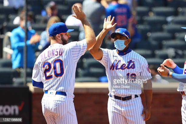 Pete Alonso of the New York Mets pumps fist with manager Luis Rojas during player introductions prior to the game against the Miami Marlins at Citi...