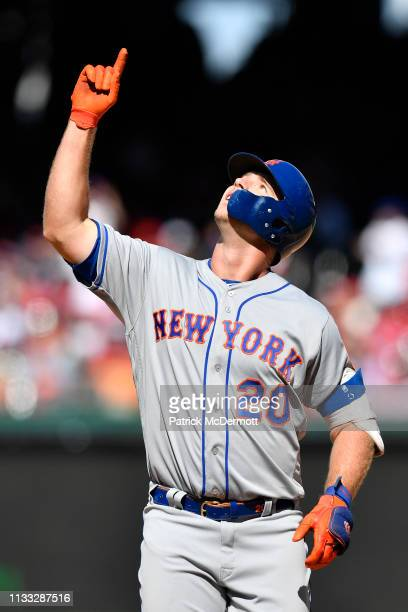 Pete Alonso of the New York Mets reacts after hitting a single for his first MLB hit in the eighth inning against the Washington Nationals on Opening...