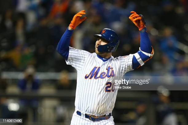 Pete Alonso of the New York Mets reacts after hitting a three run home run in the seventh inning against the Milwaukee Brewers at Citi Field on April...