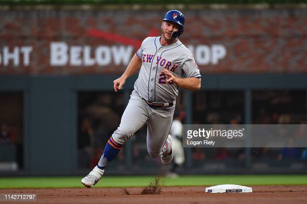 Pete Alonso of the New York Mets runs to third base against the Atlanta Braves during the game at SunTrust Park on April 14 2019 in Atlanta Georgia...