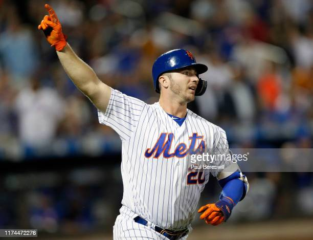 Pete Alonso of the New York Mets runs up the first base line with his finger held high as he watches after hitting his 42nd home run of the season to...