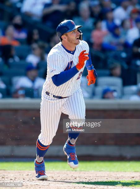 Pete Alonso of the New York Mets watches his eighth inning home run against the Washington Nationals at Citi Field on April 06 2019 in the Flushing...
