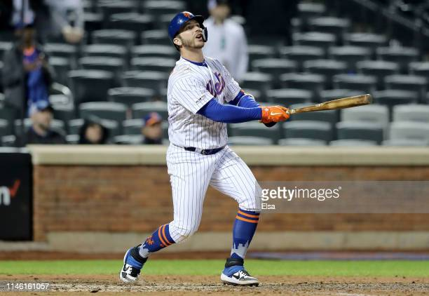 Pete Alonso of the New York Mets watches his sacrifice fly that drives in the game winning run in the 10th inning against the Cincinnati Reds at Citi...