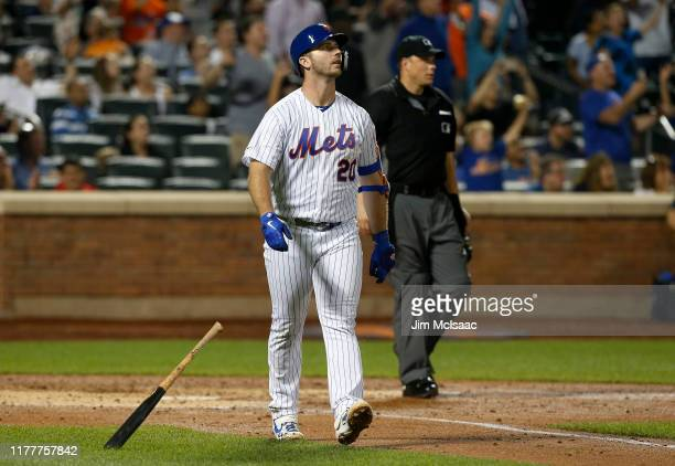 Pete Alonso of the New York Mets watches the flight of his third inning home run against the Atlanta Braves at Citi Field on September 28 2019 in New...