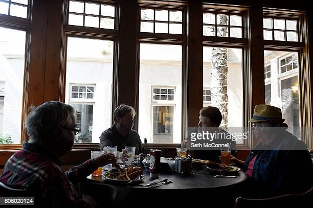 Pete Brennan left Ted Brennan Lou Price and Cindy Brennan eat lunch at Pegasus Restaurant in Castle Rock Colorado on September 13 2016 Pegasus...
