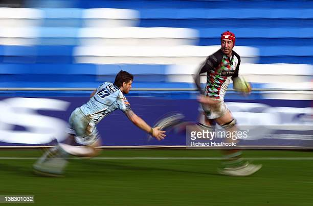 Pete Brown of Quins sprints away from Gavin Evans of Cardiff during the LV= Cup match between Cardiff Blues and Harlequins at the Cardiff City...