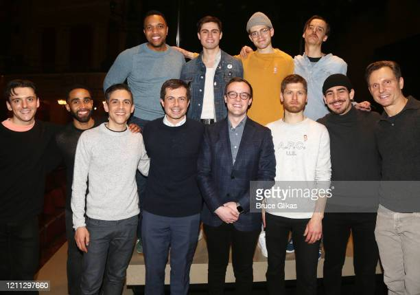 Pete Buttigieg and husband Chasten Buttigieg pose with Playwright Matthew Lopez and the cast backstage at the hit play The Inhertance on Broadway at...