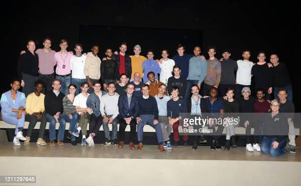 Pete Buttigieg and husband Chasten Buttigieg pose with the cast and company backstage at the hit play The Inhertance on Broadway at The Barrymore...