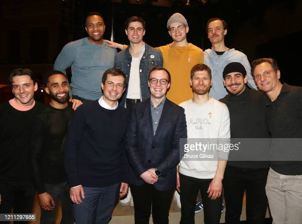 Pete Buttigieg and husband Chasten Buttigieg pose with the cast backstage at the hit play The Inhertance on Broadway at The Barrymore Theatre on...