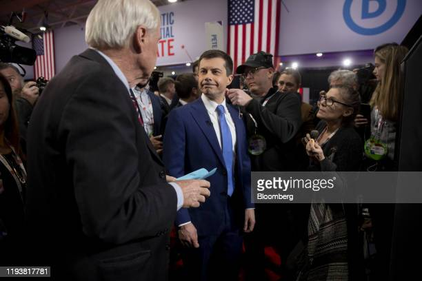Pete Buttigieg former mayor of South Bend and 2020 presidential candidate has a microphone put on ahead of an interview in the spin room following...