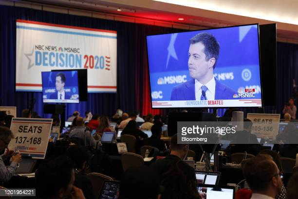 Pete Buttigieg former mayor of South Bend and 2020 presidential candidate is seen on television screens in the spin room during the Democratic...