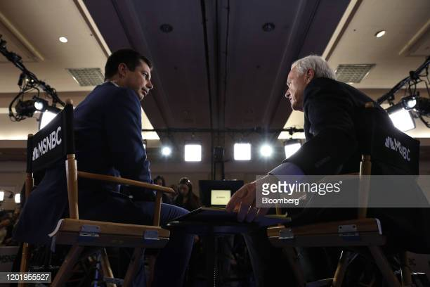 Pete Buttigieg former mayor of South Bend and 2020 presidential candidate left speaks to a member of the media following the Democratic presidential...