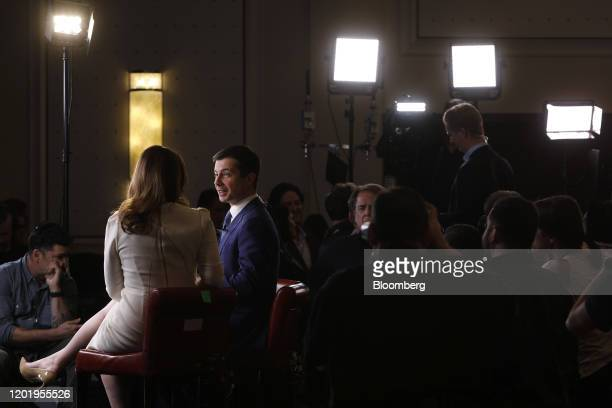 Pete Buttigieg former mayor of South Bend and 2020 presidential candidate second left speaks to a member of the media following the Democratic...