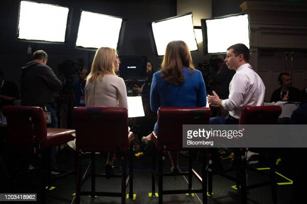 Pete Buttigieg former mayor of South Bend and 2020 presidential candidate right speaks to members of the media following the Democratic presidential...