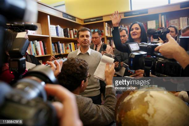 Pete Buttigieg left mayor of South Bend IN takes questions from the media with his communication advisor Lis Smith right after speaking at Gibson's...
