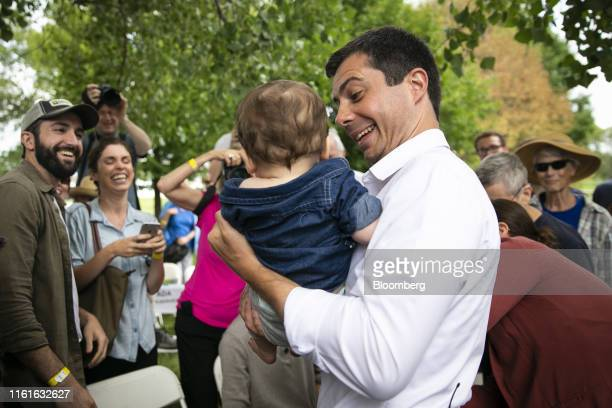 Pete Buttigieg mayor of South Bend and 2020 presidential candidate holds a baby following a town hall event at the Cedar County Fairgrounds in Tipton...