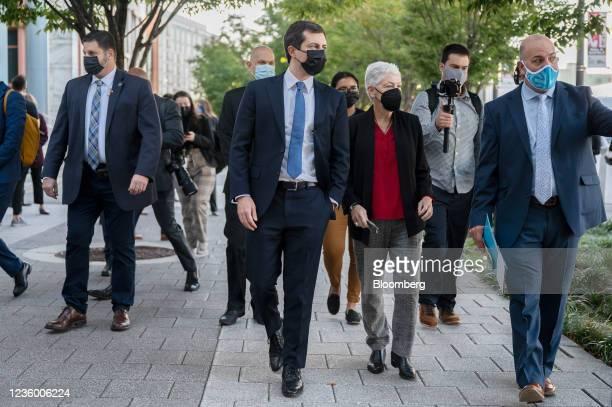 Pete Buttigieg, U.S. Secretary of transportation, center, and Gina McCarthy, White House national climate advisor, center right, listen as Ben...