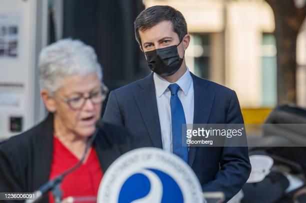 Pete Buttigieg, U.S. Secretary of transportation, listens as Gina McCarthy, White House national climate advisor, left, speaks during an electric...