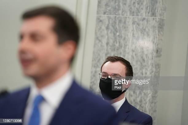 Pete Buttigieg, U.S. Secretary of transportation nominee for U.S. President Joe Biden, left, speaks as husband Chasten Buttigieg, right, wears a...