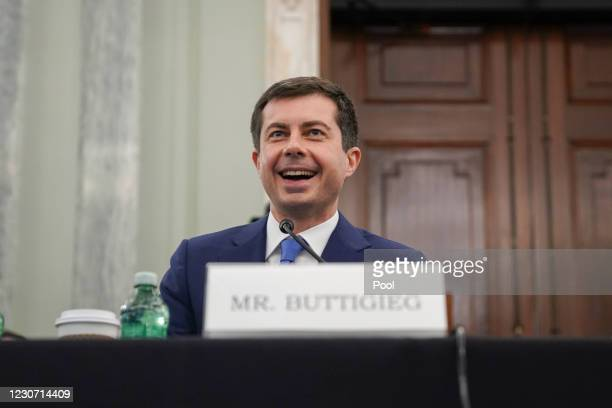 Pete Buttigieg, U.S. Secretary of transportation nominee for U.S. President Joe Biden, smiles during a Senate Commerce, Science and Transportation...