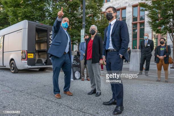 Pete Buttigieg, U.S. Secretary of transportation, right, and Gina McCarthy, White House national climate advisor, center, listen as Ben Prochazka,...