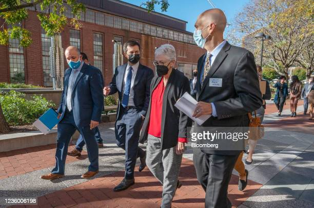 Pete Buttigieg, U.S. Secretary of transportation, second left, speaks to Joel Levin, executive director of Plug In America, right, with Gina...
