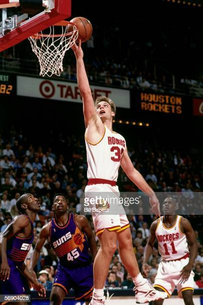 Pete Chilcutt of the Houston Rockets drives to the basket for a layup against the Phoenix Suns during an NBA game at the Summit on March 7 1995 in...
