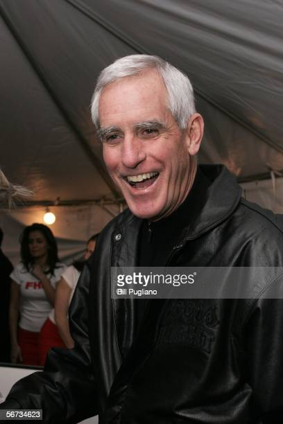 Pete Coors chairman of Coors Brewing Company speaks with the media in the red carpet arrival area at the FHM third annual Players Party February 2...
