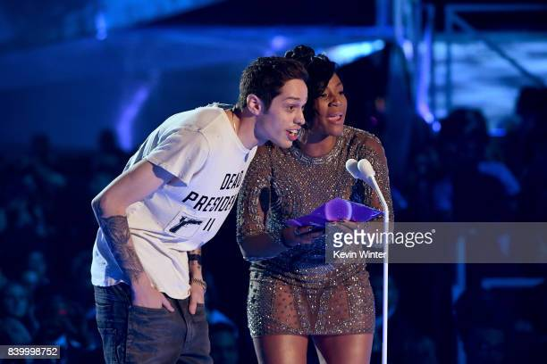 Pete Davidson and Tiffany Haddish speak onstage during the 2017 MTV Video Music Awards at The Forum on August 27 2017 in Inglewood California