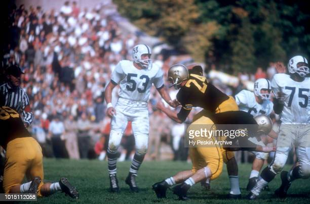 Pete Dawkins of the Army Cadets runs the fake during an NCAA game against the Penn State Nittany Lions on October 4 1958 at Michie Stadium in West...