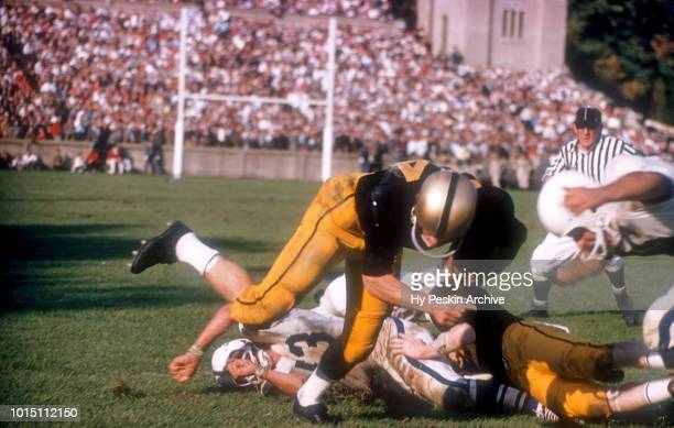 Pete Dawkins of the Army Cadets runs with the ball as an unidentified player of the Penn State Nittany Lions gets ready for the tackle during an NCAA...