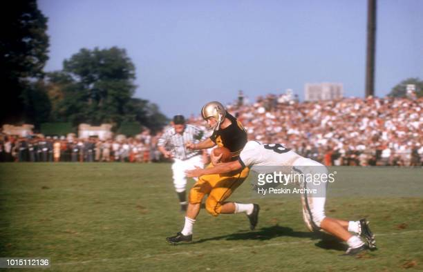 Pete Dawkins of the Army Cadets runs with the ball as John Bozick of the Penn State Nittany Lions goes for the tackle during an NCAA game on October...