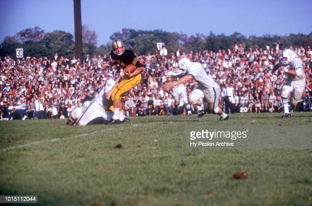 Pete Dawkins of the Army Cadets runs with the ball as Sam Sobczak of the Penn State Nittany Lions goes for the tackle during an NCAA game on October...